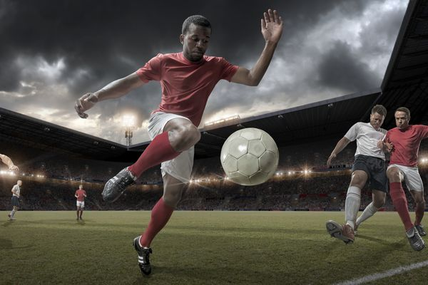 Man playing soccer in an arena