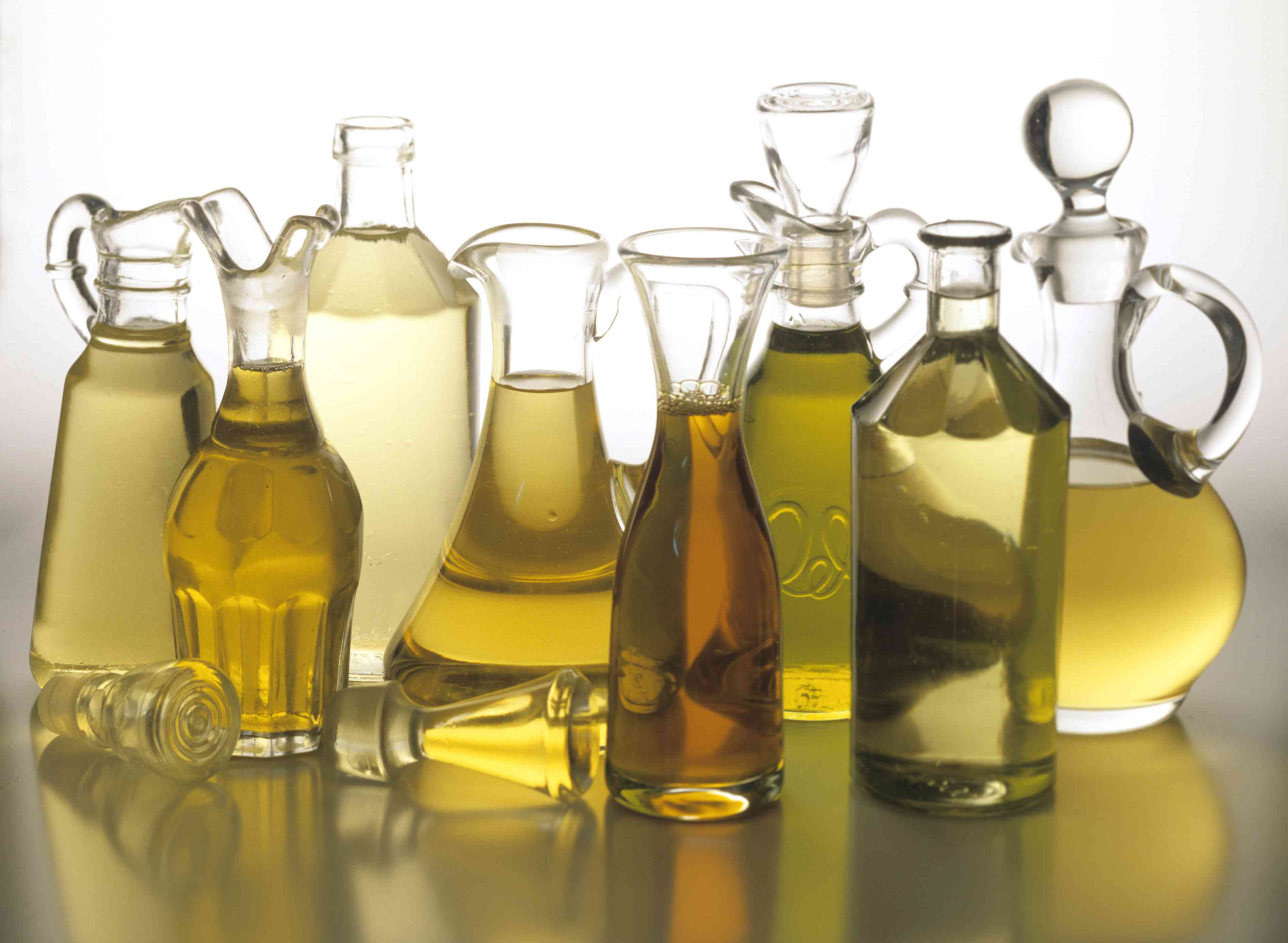 Various cooking oils in glass bottles