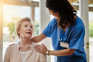 Patient comforted by doctor