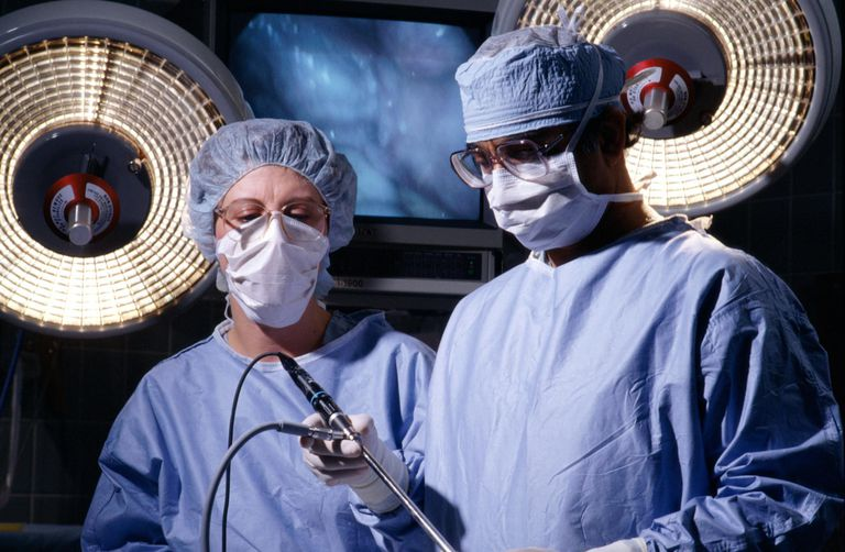 two doctors with a laparoscope