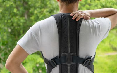 Picture of a man in a back brace.