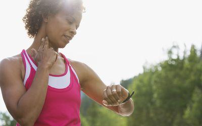 Runner taking her pulse at the common carotid artery