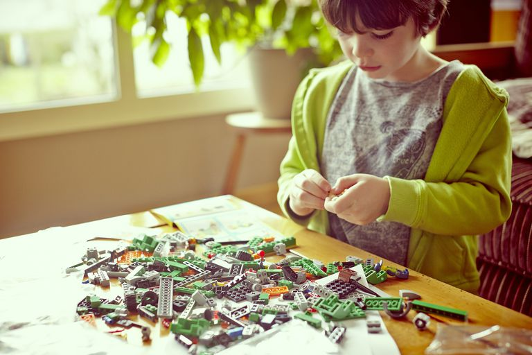 a child sorting legos
