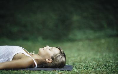 woman relaxing on a yoga mat