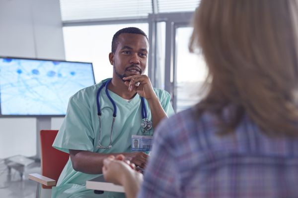 Doctor speaking with woman