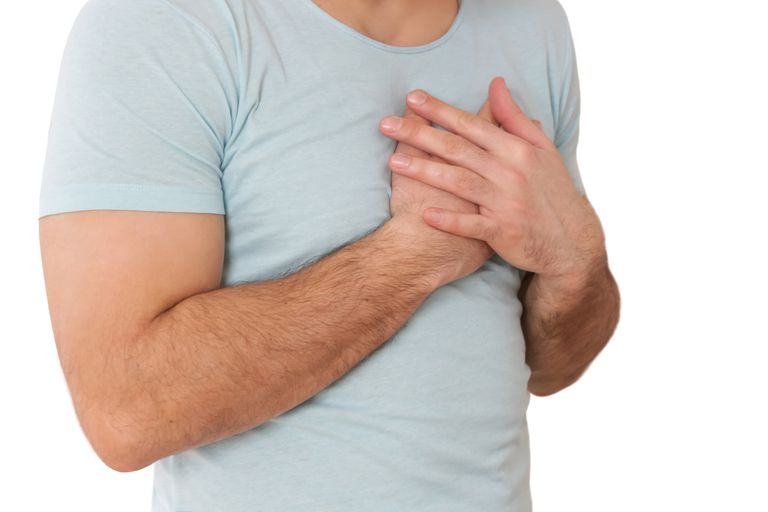 Chest Pain, Young man holding hand to spot chest pain