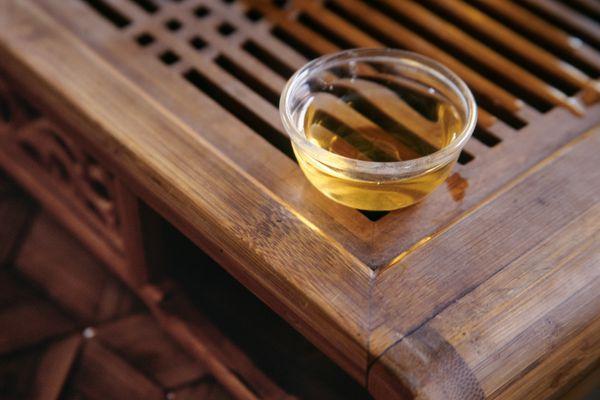 Pu-er tea in glass on bamboo stand