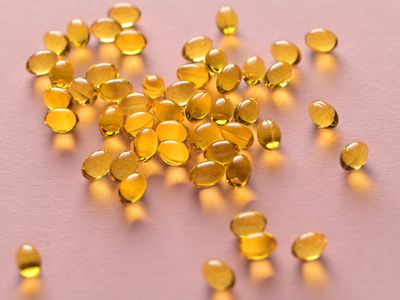 Close up capsules of fish fat oil Getty Image
