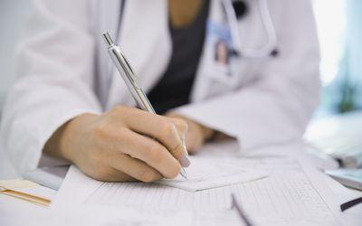 Female doctor writing