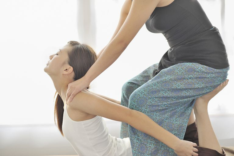 Young woman receiving Thai massage