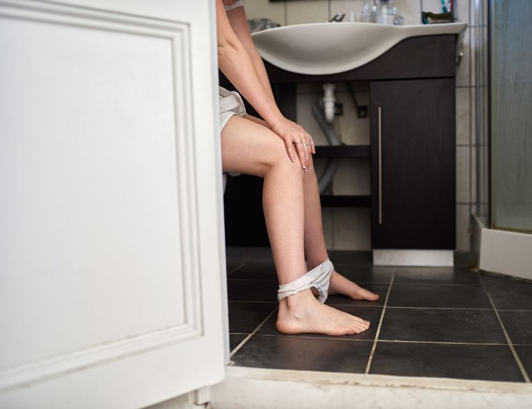View of woman's legs in a bathroom