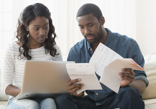 Young couple discussing medical paperwork