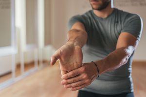 Man stretching forearm