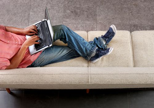 Man on couch with laptop