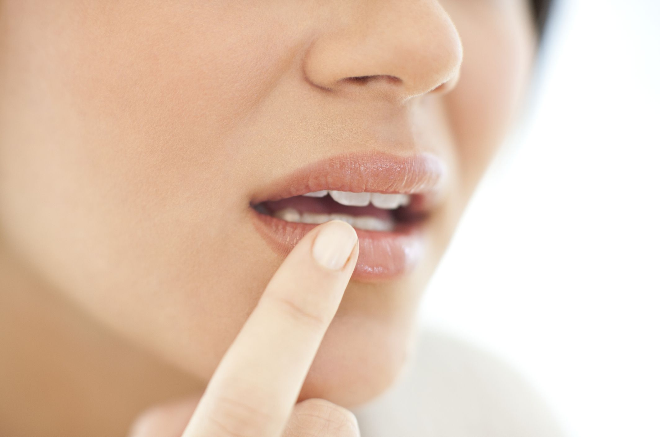 woman looking at mouth