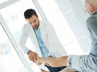 Doctor examining leg