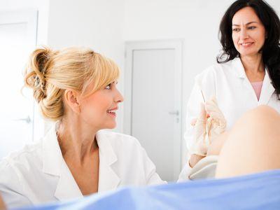 Doctor obtaining a cervical smear