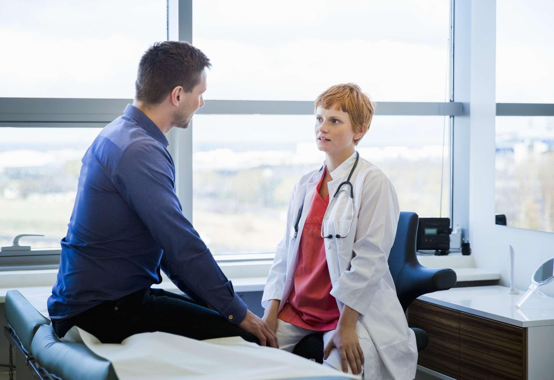 Man talking to female doctor