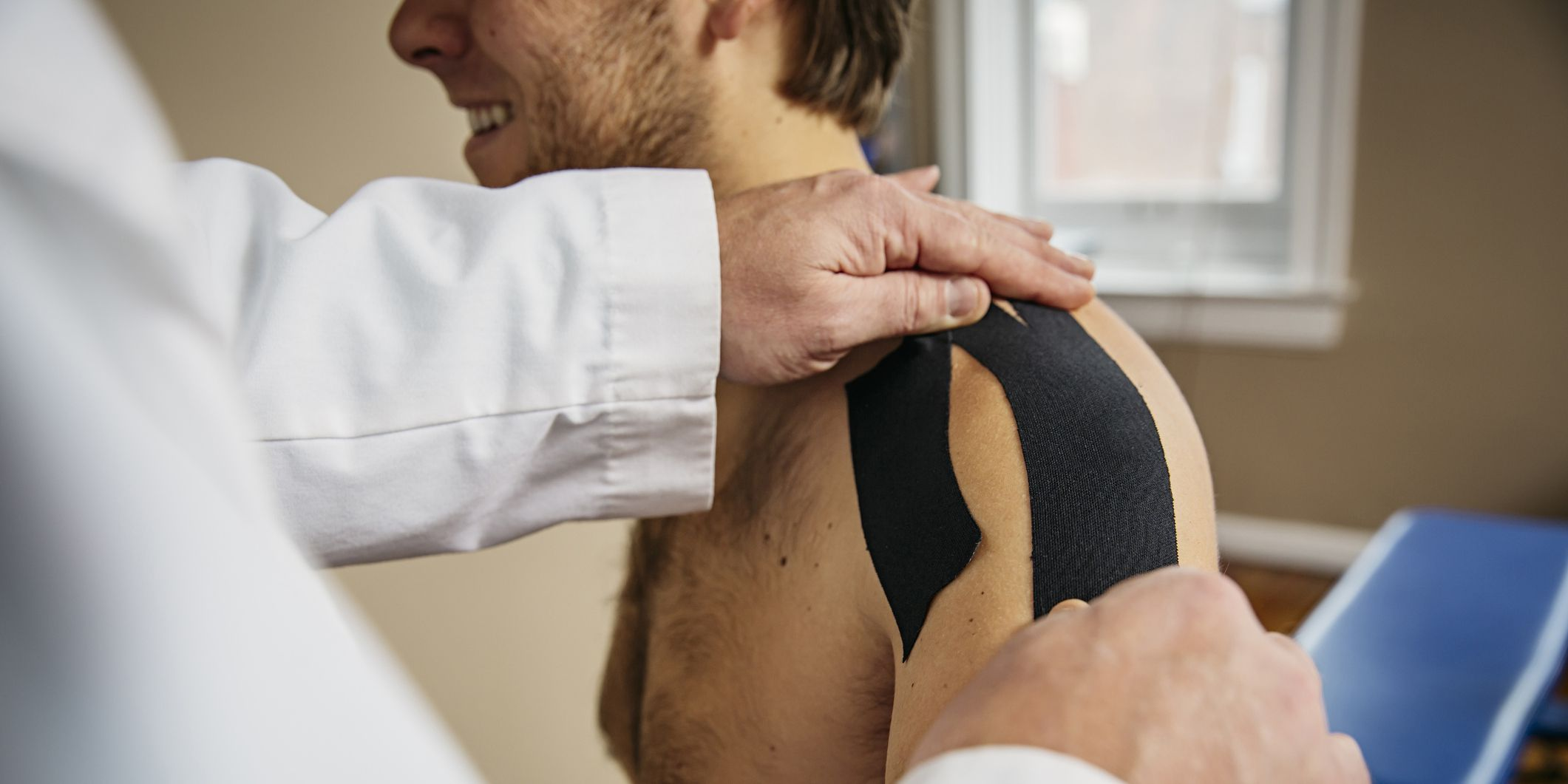Orthopedist applying shoulder tape