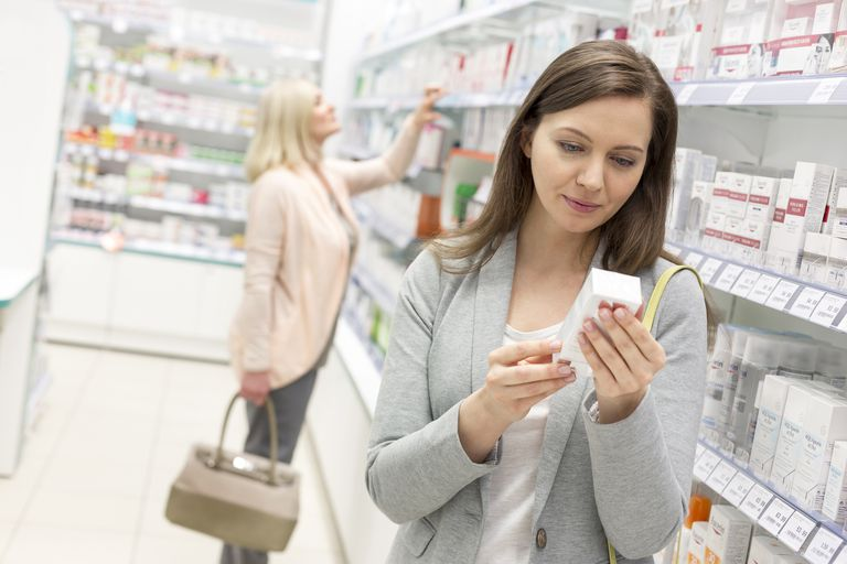 Woman looking at medication