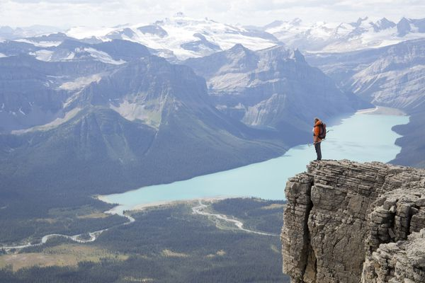 Person looking over a cliff