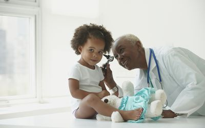 doctor looking in child's ear