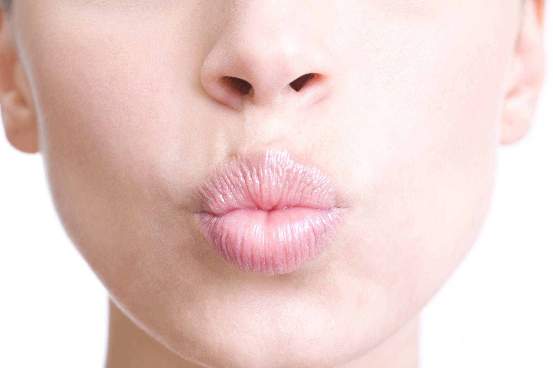 Woman puckering lips