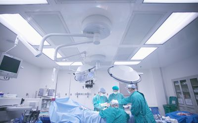 Doctors performing surgery in operating room