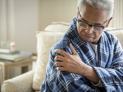 Man holding shoulder in pain