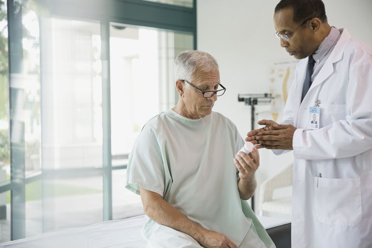 a doctor discussing medication with a male senior patient