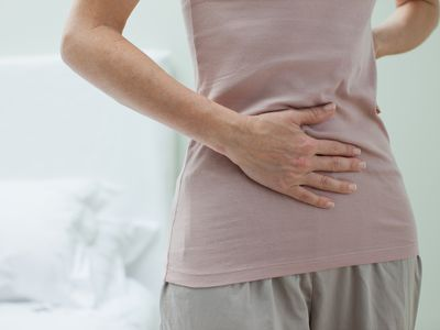 Woman rubbing abdomen
