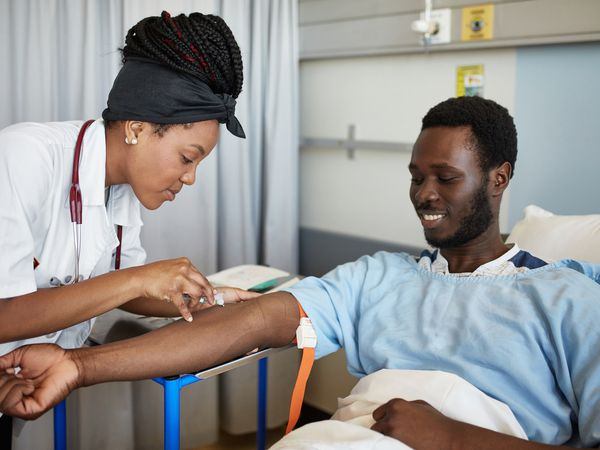 Teenage African Medical Student Drawing Blood in Hospital