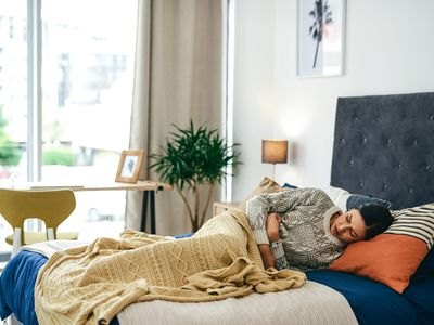 Woman in bed with pelvic pain