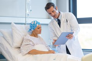 woman learning about a diagnosis of peritoneal cancer from doctor