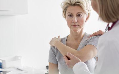 Doctor examining patients shoulder