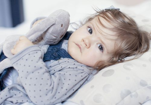 Young toddler girl in bed