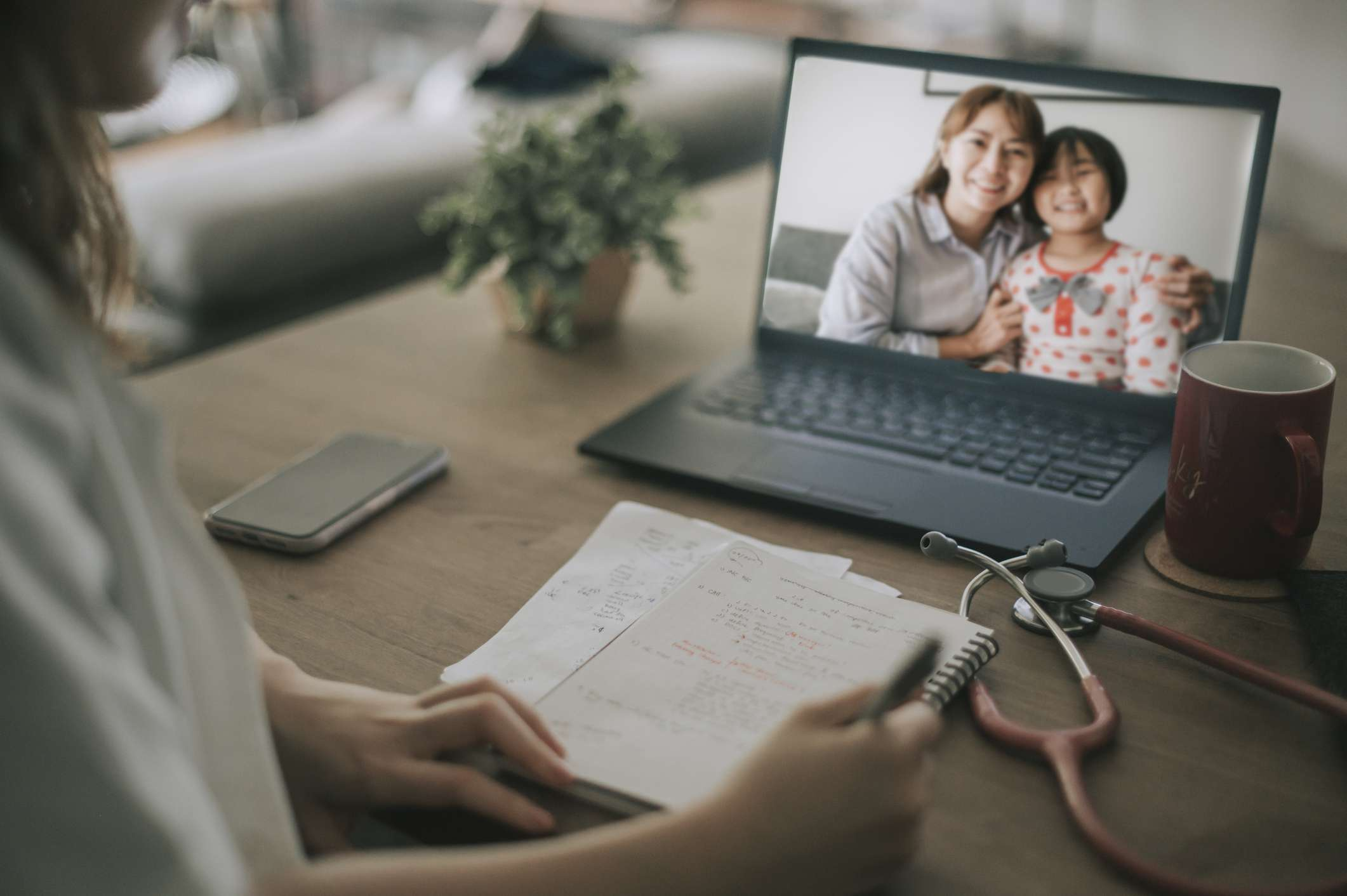 Telehealth visit with mother and child