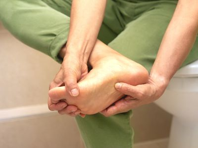 Woman with pain in her foot after sports injury