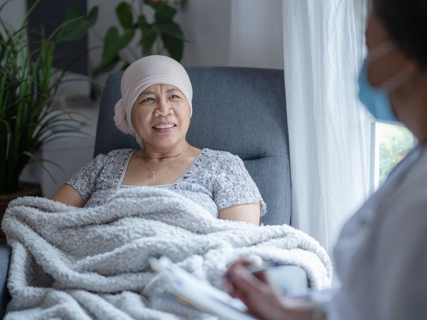 Asian female cancer patient smiling to doctor
