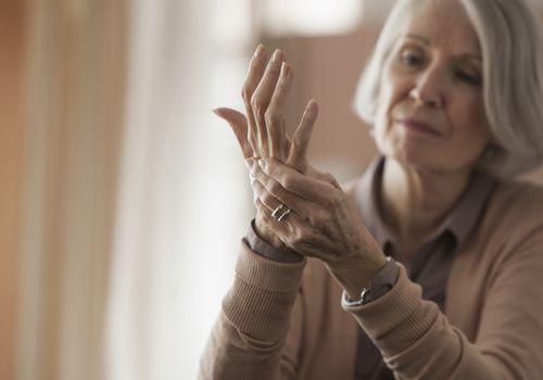 Senior Caucasian woman rubbing her hands