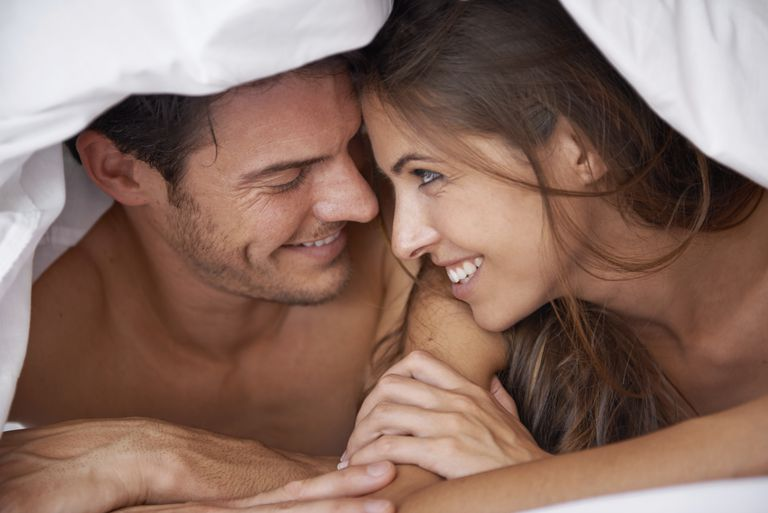 A man and woman in bed together