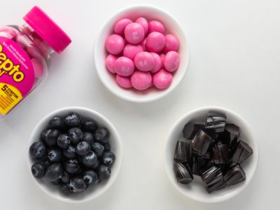 Bowls of blueberries, black licorice, and chewable pepto bismol