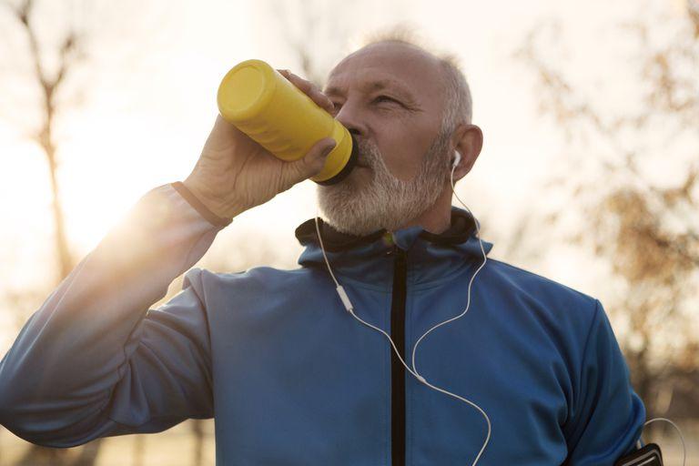 Senior runner hydrating