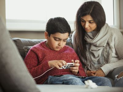 Mother and child looking at mobile phone