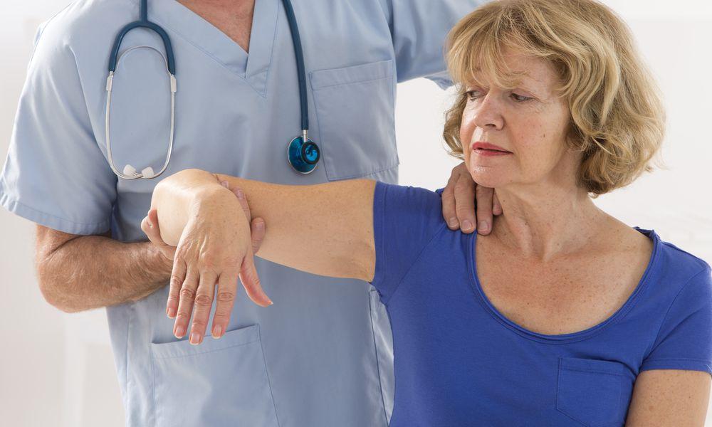 Rheumatology consultation, Doctor examining a patients shoulder