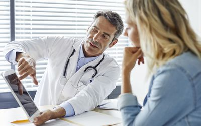 Doctor showing patient test results