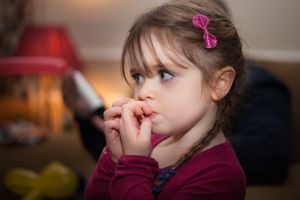 Child biting fingernails