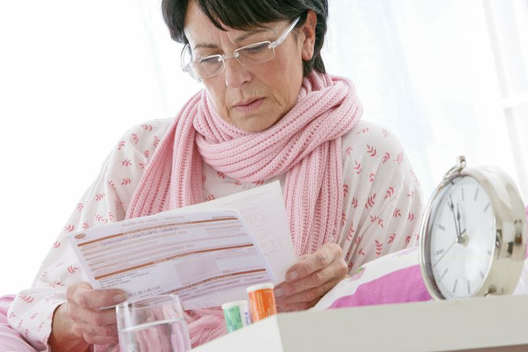woman looking at health insurance paperwork