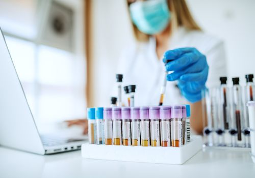 Woman completing research in lab