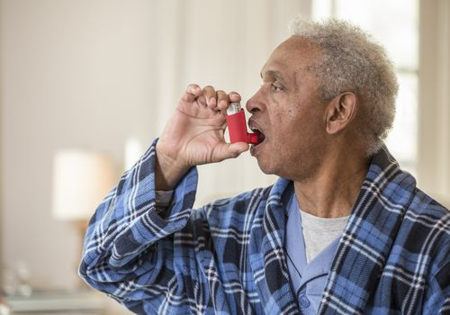 Man using an inhaler